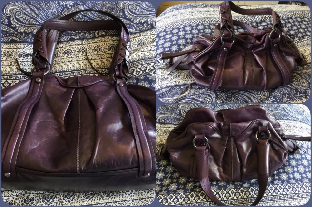 Purple leather handbag by Francesco Biasia