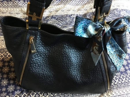 Dans un Jardin Anglais twilly by Hermès tied on Massaccesi handbag